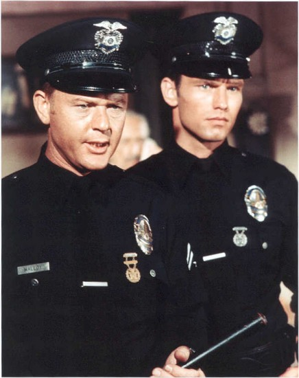 Officers Pete Malloy (Martin Milner) and Jim Reed (Kent McCord) from the Adam-12 television series.