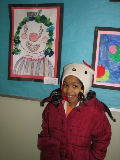 Naomi with her artwork.