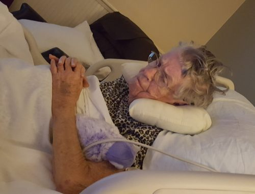 Mom watching a video of her favorite grandchild