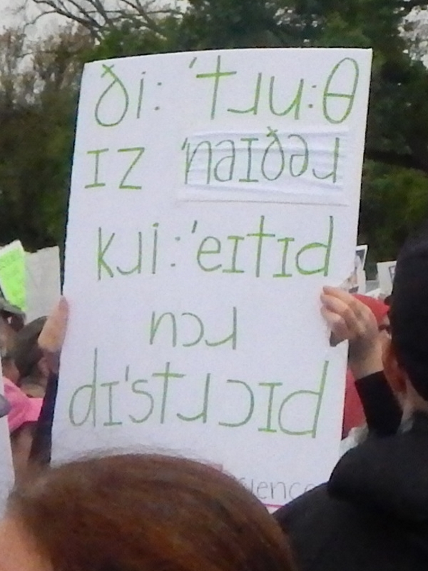 "(Written using the IPA) The Truth Is Neither Created Nor DestroyedAs I recall, this person had another sign that talked about ""even this linguist is marching."""
