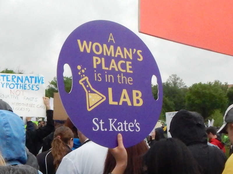 A Woman's Place Is in the Lab. (St. Kate's, apparently from St. Catherine University.)