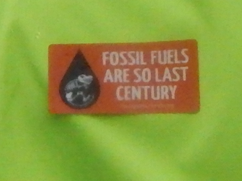 Fossil Fuels Are So Last Century. (This was stuck on the back of a guy's jacket.)