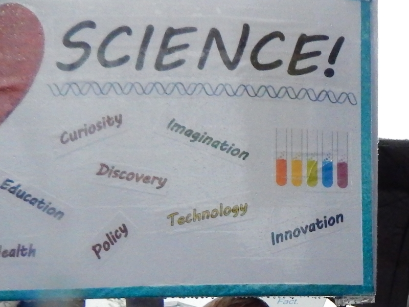 Science! Education. Health. Curiosity. Policy. Discovery. Imagination. Technology. Innovation. (The other side of Dr. Jean Cook's sign.)