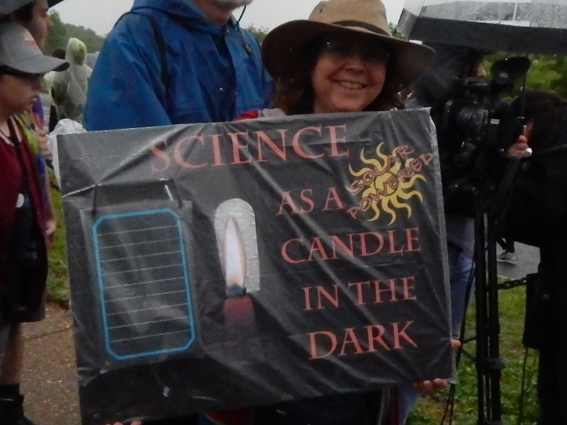 Science as a Candle in the Dark. (This sign featured a solar-powered LED candle.)